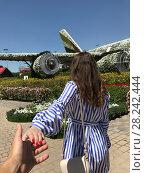 Купить «Follow me photo of a beautiful young girl on a background of flowers.», фото № 28242444, снято 21 марта 2018 г. (c) Женя Канашкин / Фотобанк Лори