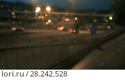 Купить «Blurred view of city highway in dusk with trace of red automobile headlight beams», видеоролик № 28242528, снято 11 августа 2017 г. (c) Яков Филимонов / Фотобанк Лори