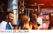 Купить «Young students dancing on party with cocktails in the club», видеоролик № 28242564, снято 11 сентября 2017 г. (c) Яков Филимонов / Фотобанк Лори