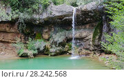 Купить «El Torrent de la Cabana small mountain stream with crystal clear water», видеоролик № 28242568, снято 16 мая 2017 г. (c) Яков Филимонов / Фотобанк Лори