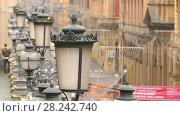 Купить «Bologna, Italy: lanterns on street dell'Indipendenza», видеоролик № 28242740, снято 26 ноября 2017 г. (c) BestPhotoStudio / Фотобанк Лори