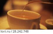 Купить «Pouring tea from glass teapot», видеоролик № 28242748, снято 8 января 2018 г. (c) Данил Руденко / Фотобанк Лори