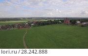 Купить «Flying over green meadows and Lukino Village in Russia», видеоролик № 28242888, снято 18 ноября 2018 г. (c) Данил Руденко / Фотобанк Лори