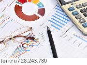Купить «Калькулятор, графики, диаграммы, очки и ручка. Бизнес-натюрморт», эксклюзивное фото № 28243780, снято 30 марта 2018 г. (c) Юрий Морозов / Фотобанк Лори
