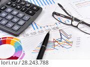 Купить «Калькулятор, графики, диаграммы, очки и ручка. Бизнес-натюрморт», эксклюзивное фото № 28243788, снято 30 марта 2018 г. (c) Юрий Морозов / Фотобанк Лори