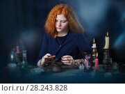 Купить «young witch is engaged in witchcraft», фото № 28243828, снято 28 марта 2018 г. (c) Майя Крученкова / Фотобанк Лори