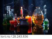 Купить «magic potions on a blue background», фото № 28243836, снято 30 марта 2018 г. (c) Майя Крученкова / Фотобанк Лори