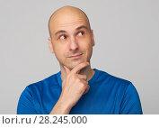 Купить «Bald guy wondering», фото № 28245000, снято 24 марта 2018 г. (c) Александр Лычагин / Фотобанк Лори
