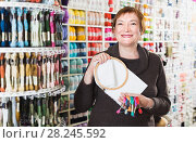 Купить «Woman standing with accessories for embroidery in store», фото № 28245592, снято 10 мая 2017 г. (c) Яков Филимонов / Фотобанк Лори
