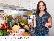 Купить «Satisfied woman checking food», фото № 28245692, снято 5 сентября 2017 г. (c) Яков Филимонов / Фотобанк Лори