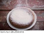Купить «chocolate sponge cake on old wooden background», фото № 28254672, снято 22 января 2018 г. (c) Майя Крученкова / Фотобанк Лори
