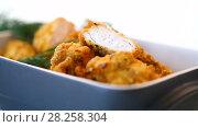 Купить «Chicken fried in batter with dill», видеоролик № 28258304, снято 4 апреля 2018 г. (c) Peredniankina / Фотобанк Лори