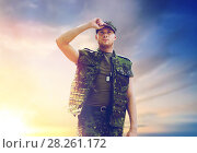 Купить «soldier in military uniform over sky background», фото № 28261172, снято 14 августа 2014 г. (c) Syda Productions / Фотобанк Лори