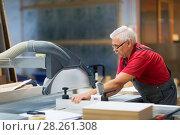 Купить «carpenter working with panel saw at factory», фото № 28261308, снято 10 ноября 2017 г. (c) Syda Productions / Фотобанк Лори