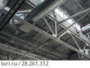Купить «ventilation pipes at factory shop», фото № 28261312, снято 10 ноября 2017 г. (c) Syda Productions / Фотобанк Лори