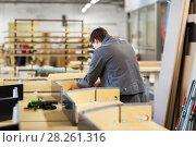 Купить «assembler making furniture factory workshop», фото № 28261316, снято 10 ноября 2017 г. (c) Syda Productions / Фотобанк Лори