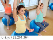 Купить «pregnant women training with exercise balls in gym», фото № 28261364, снято 5 марта 2016 г. (c) Syda Productions / Фотобанк Лори