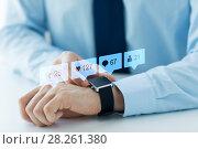 Купить «hands with smart watch and social media icons», фото № 28261380, снято 13 августа 2015 г. (c) Syda Productions / Фотобанк Лори