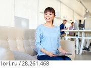 Купить «happy asian woman with laptop working at office», фото № 28261468, снято 27 февраля 2016 г. (c) Syda Productions / Фотобанк Лори
