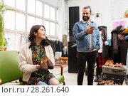 Купить «couple choosing footwear at vintage clothing store», фото № 28261640, снято 30 ноября 2017 г. (c) Syda Productions / Фотобанк Лори
