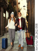 Купить «male and female in the historic center with baggage», фото № 28262008, снято 18 ноября 2017 г. (c) Яков Филимонов / Фотобанк Лори