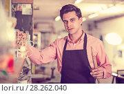 Купить «Portrait of craftsman in carpentry», фото № 28262040, снято 8 апреля 2017 г. (c) Яков Филимонов / Фотобанк Лори