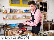 Купить «Craftsman working on woodworking machine», фото № 28262044, снято 8 апреля 2017 г. (c) Яков Филимонов / Фотобанк Лори