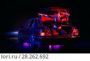 Купить «Hiphop young girl near the car red and blue light and fog», фото № 28262692, снято 22 сентября 2019 г. (c) Aleksejs Bergmanis / Фотобанк Лори
