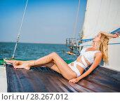 Купить «woman in fashion white swimsuit sitting on yacht», фото № 28267012, снято 25 июля 2017 г. (c) katalinks / Фотобанк Лори