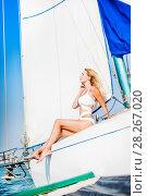 Купить «woman in fashion white swimsuit sitting on yacht», фото № 28267020, снято 25 июля 2017 г. (c) katalinks / Фотобанк Лори