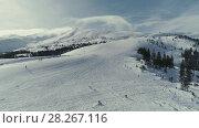 Купить «Winter Snowboarding and Ski drone flight in mountains skilift above elevator and peoples», видеоролик № 28267116, снято 6 февраля 2018 г. (c) Aleksejs Bergmanis / Фотобанк Лори