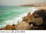 Young woman on a big stone of Praia das Macas. Sintra, Portugal. Стоковое фото, фотограф Сергей Цепек / Фотобанк Лори