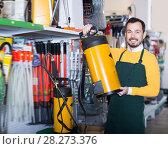 Купить «Glad guy deciding on best garden sprayer», фото № 28273376, снято 2 марта 2017 г. (c) Яков Филимонов / Фотобанк Лори