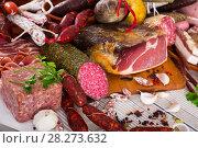 Купить «Variety of meats on table», фото № 28273632, снято 18 октября 2018 г. (c) Яков Филимонов / Фотобанк Лори