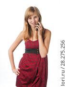 Купить «Девушка в платье говорит по старому телефону-раскладушке», эксклюзивное фото № 28275256, снято 12 сентября 2010 г. (c) Давид Мзареулян / Фотобанк Лори