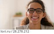 Купить «face of smiling african american woman in glasses», видеоролик № 28278212, снято 26 марта 2018 г. (c) Syda Productions / Фотобанк Лори