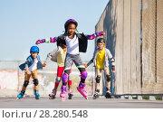 Купить «Cute African girl rollerblading at stadium», фото № 28280548, снято 14 октября 2017 г. (c) Сергей Новиков / Фотобанк Лори
