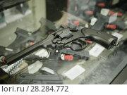 Купить «pistol on the glass table in army shop», фото № 28284772, снято 4 июля 2017 г. (c) Яков Филимонов / Фотобанк Лори