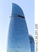 Купить «View of the Fiery Towers. Skyscraper of unusual shape in the center of Baku», фото № 28291200, снято 23 сентября 2017 г. (c) Евгений Ткачёв / Фотобанк Лори
