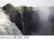 Купить «Victoria Falls Waterfall, Zambezi River at the border of Zimbabwe and Zambia, Mosi-oa-Tunya / Victoria Falls UNESCO World Heritage Site. Photographed for The Freshwater Project in July 2014», фото № 28291316, снято 21 августа 2018 г. (c) Nature Picture Library / Фотобанк Лори
