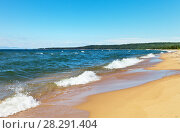 Купить «A beautiful sandy deserted beach and waves of blue water in summer on Lake Baikal», фото № 28291404, снято 26 августа 2016 г. (c) Виктория Катьянова / Фотобанк Лори