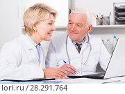 Купить «Male doctor and nurse», фото № 28291764, снято 28 мая 2020 г. (c) Яков Филимонов / Фотобанк Лори
