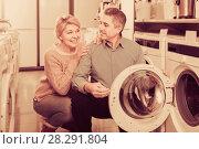Купить «Mature couple choosing washing machine in store», фото № 28291804, снято 27 марта 2019 г. (c) Яков Филимонов / Фотобанк Лори