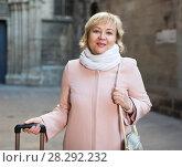 Купить «portrait of mature female with baggage», фото № 28292232, снято 27 ноября 2017 г. (c) Яков Филимонов / Фотобанк Лори