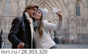 Купить «Adult tourists taking selfie on mobile phone at historical street», видеоролик № 28303320, снято 27 ноября 2017 г. (c) Яков Филимонов / Фотобанк Лори