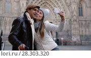 Купить «Adult tourists taking selfie on mobile phone at historical street», видеоролик № 28303320, снято 27 ноября 2017 г. (c) Яков Филимонов / Фотобанк Лори