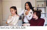Купить «Portrait of upset little girl scolded by mother and grandma at home», видеоролик № 28303324, снято 27 ноября 2017 г. (c) Яков Филимонов / Фотобанк Лори