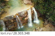 Купить «El Torrent de la Cabana small mountain stream with crystal clear water», видеоролик № 28303348, снято 23 марта 2018 г. (c) Яков Филимонов / Фотобанк Лори