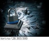 Купить «Padlock on CPU computer circuit board. Lock over the motherboard. Network security concept.», фото № 28303500, снято 23 марта 2019 г. (c) Maksym Yemelyanov / Фотобанк Лори