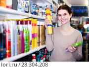 Купить «happy woman customer deciding on hair care products in shop», фото № 28304208, снято 21 февраля 2017 г. (c) Яков Филимонов / Фотобанк Лори